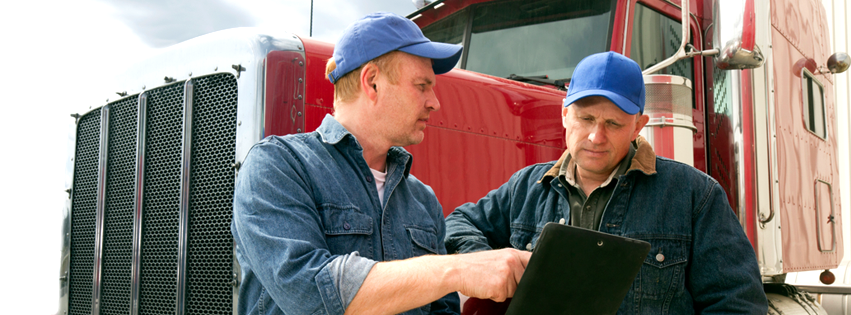 CMV Driving Safety modules provide information for disucssion with and among drivers. Image of two truck drivers having a discussion.